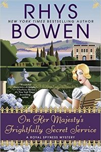 Cover art: a stylized illustration of a young lady with a wavy blond bob, looking at us over her shoulder. She's seated in a lawn chair overlooking a formal Italian garden with manicured hedges and a fountain. A classical villa behind her sits on the shores of a lake, with mountains beyond.
