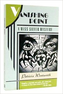 Cover art: A stylized gray and black drawing of a spider in a web. A woman's eyes peer out through the web.